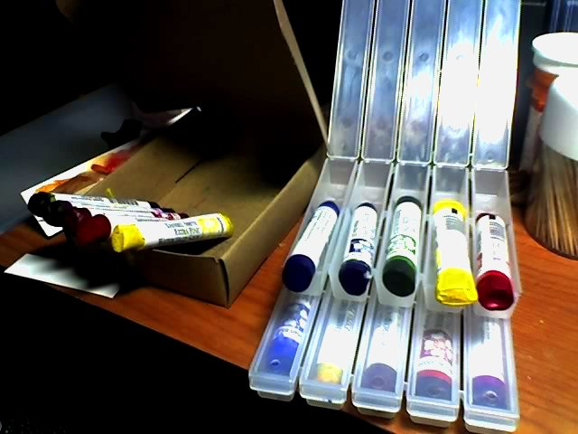 Product photo of 15 Daniel Smith watercolor sticks in cardboard box and two plastic cases.