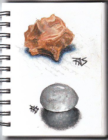 ProArt wirebound sketchbook page with red-brown chert study and clear quartz pebble drawn in oil pastels.
